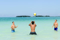 People playing volleyball in clear water of Cayo Guillermo beach Royalty Free Stock Photo
