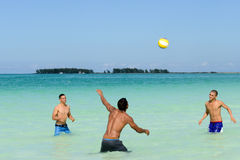 People playing volleyball in clear water of Cayo Guillermo beach Royalty Free Stock Photography