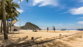 People playing volleyball on Copacabana Beach stock video