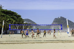 People playing volleyball in Copacabana Beach in Rio de Janeiro, Brazil Royalty Free Stock Images