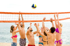 People playing volleyball on summer day Stock Images