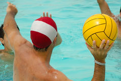 People are playing water polo. In swimming pool Royalty Free Stock Image