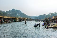 People are playing in the water, at Shwe Set Taw pagoda festival, Myanmar, Feb-2018