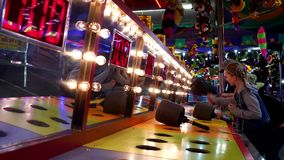 People playing whack game at West Coast Amusements Carnival stock video footage