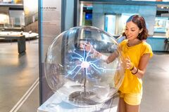 Free People Playing With Plasma Ball In Science Museum Stock Images - 173245144