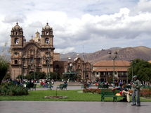 People at Plaza de Armas, Cusco, Peru. Busy, bustling and historic square Plaza de Armas with church, cathedral and park, Cusco, Cusco province, Peru Stock Image