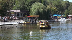 People on pleasure boats in the pond Globa Park last Chkalov stock video