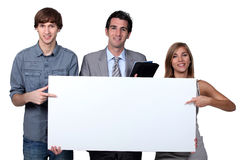 People pointing at blank board Stock Image