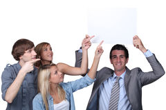 People pointing at sign Royalty Free Stock Image