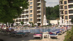 People at the pool in a tourist complex in Golden Sands in Bulgaria. Varna - the sea capital of Bulgaria, a center of shipping and tourism. Today it is the third stock footage
