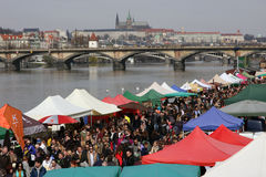 People at the popular farmers market at the Naplavka riverbank in Prague. PRAGUE, CZECH REPUBLIC - MARCH 25, 2017: People at the popular farmers market at the royalty free stock images