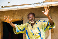 People in PORTO-NOVO, BENIN. PORTO-NOVO, BENIN - MAR 8, 2012: Portrait of the unidentified funny Beninese man waves hands and smiles. People of Benin suffer of royalty free stock photos