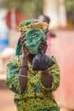 People in PORTO-NOVO, BENIN. PORTO-NOVO, BENIN - MAR 8, 2012: Unidentified Beninese girl shuts her head. People of Benin suffer of poverty due to the difficult stock images