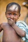 People in PORTO-NOVO, BENIN. PORTO-NOVO, BENIN - MAR 8, 2012: Unidentified Beninese little boy shuts his mouth. People of Benin suffer of poverty due to the stock image