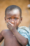 People in PORTO-NOVO, BENIN. PORTO-NOVO, BENIN - MAR 8, 2012: Unidentified Beninese little boy shuts his mouth. People of Benin suffer of poverty due to the stock images