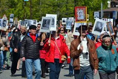 People with portraits of the died relatives participate in demon. Stration in honor of a Victory Day on May 9, 2016. Tyumen, Russia Royalty Free Stock Photos