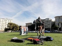 People pose for photo with cast of Full House Stock Images