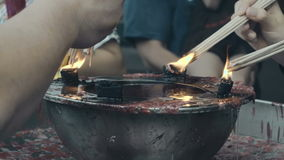 People pour oil at the China Temple stock footage