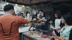 People pour oil at the China Temple stock video footage