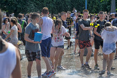 People pour water on each other Royalty Free Stock Photo