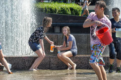 People pour water on each other Royalty Free Stock Image
