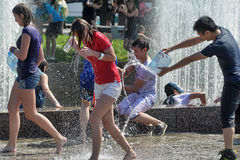 People pour water on each other Stock Photo