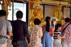 People pour water onto a Buddha images is a gesture of worship. During the annual Songkran festival at Saiyai temple on April 13, 2016 in Nonthaburi, Thailand Royalty Free Stock Photo