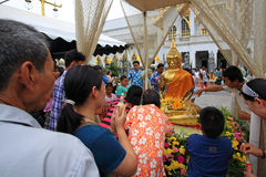 People pour water to Buddha statue on Songkran day. CHACHOENGSAO, THAILAND-APR 13: Unidentified people pour water to Buddha statue on Songkran, traditional Thai Royalty Free Stock Photos
