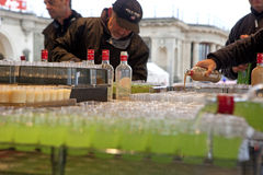 People pouring drinks, Belgium Royalty Free Stock Photo