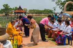 People pouring water to seniors` hands to ask for blessing. Ubon Ratchathani, Thailand - May 2, 2016: People pouring water to seniors` hands to ask for blessing Royalty Free Stock Images