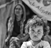 People. Poverty child women bnw stock photo