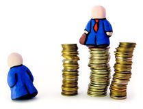 People, power, money. Two mens statuette: subordinate and boss(on coins rouleaus stock photo