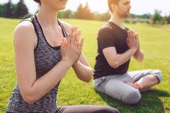 People practice acro yoga outdoors healthy lifestyle. Man and women practice acro yoga in the park meditation Royalty Free Stock Photos