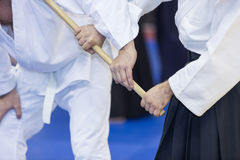 People practice Aikido with wooden jo royalty free stock photos