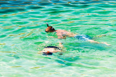 People practice snorkeling in the clear and transparent water. Stock Photography