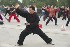 People practice tai chi chuan gymnastics in Beijing, China. Stock Images