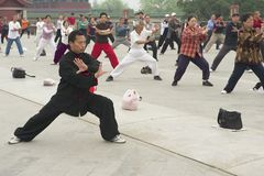 People practice tai chi chuan gymnastics in Beijing, China. Royalty Free Stock Image