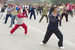 People practice tai chi chuan gymnastics in Beijing, China. Stock Image