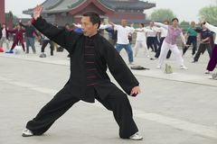 People practice tai chi chuan gymnastics in Beijing, China. Royalty Free Stock Photos