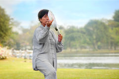 People practice Tai Chi Chuan in a park. BANGKOK, THAILAND - FEBRUARY 20, 2016: Unidentified people practice Tai Chi Chuan - Chinese exercising martial art in a Stock Image