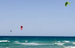 People practicing kitesurf on the beach of Torre Canne Royalty Free Stock Image