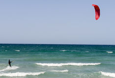 People practicing kitesurf on the beach of Torre Canne Stock Photos