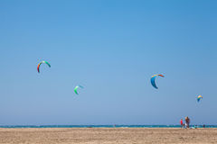 People practicing Kitesurfing. Beach on the peninsula Prasonisi, Greece. Stock Images