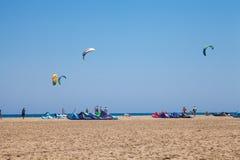 People practicing Kitesurfing. Beach on the peninsula Prasonisi, Greece. Royalty Free Stock Photo