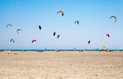 People practicing Kitesurfing. Beach on the peninsula Prasonisi, Stock Images