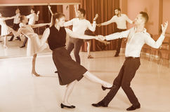 People practicing lindy hop movements Stock Photo
