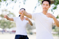 People practicing thai chi in park Stock Image