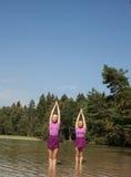 People practicing yoga Stock Image