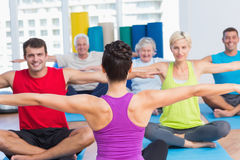 People practicing yoga in health club Royalty Free Stock Photos