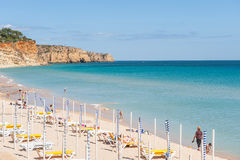 People on Praia De Mos beach in Lagos, Algarve, Portugal. Stock Image